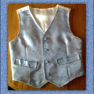 Cody Vest in blue, gold & ivory